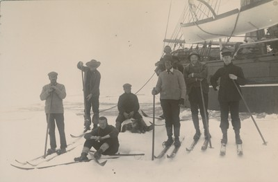Group of officers on floe alongside ship in pack ice