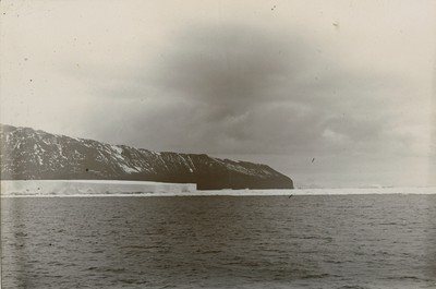 Cape Adare with large iceberg in front