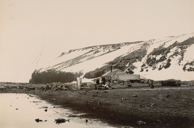 Southern Cross Hut with Cape Adare in background