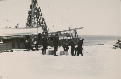 Loading ship with ice. Seal meat in rigging