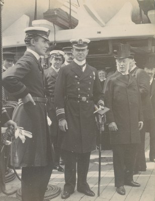 Officers and Sir Leopold McClintock watching departure of H.M. The King