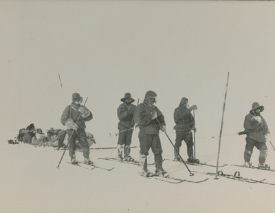 Sledge party on ski hauling sledges
