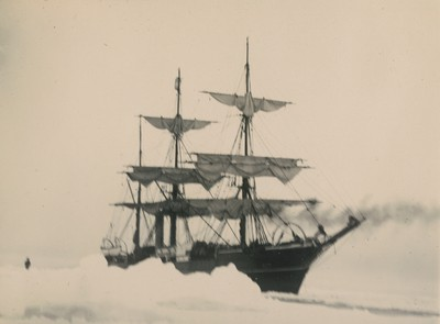 Ship tied up to ice floe