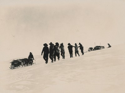 Western sledge journey. Hauling sledges up steep incline.
